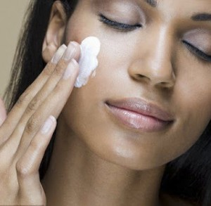 Lady using facial cream