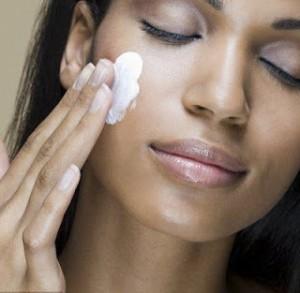 Lady using facial cream